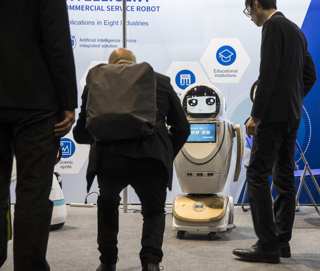 The Chuangze Intelligent Robot wows convention goers during the first day of CES 2019 on Tuesday, Jan. 8, 2019, at the Las Vegas Convention Center, in Las Vegas. The four day tech event brings ove ...