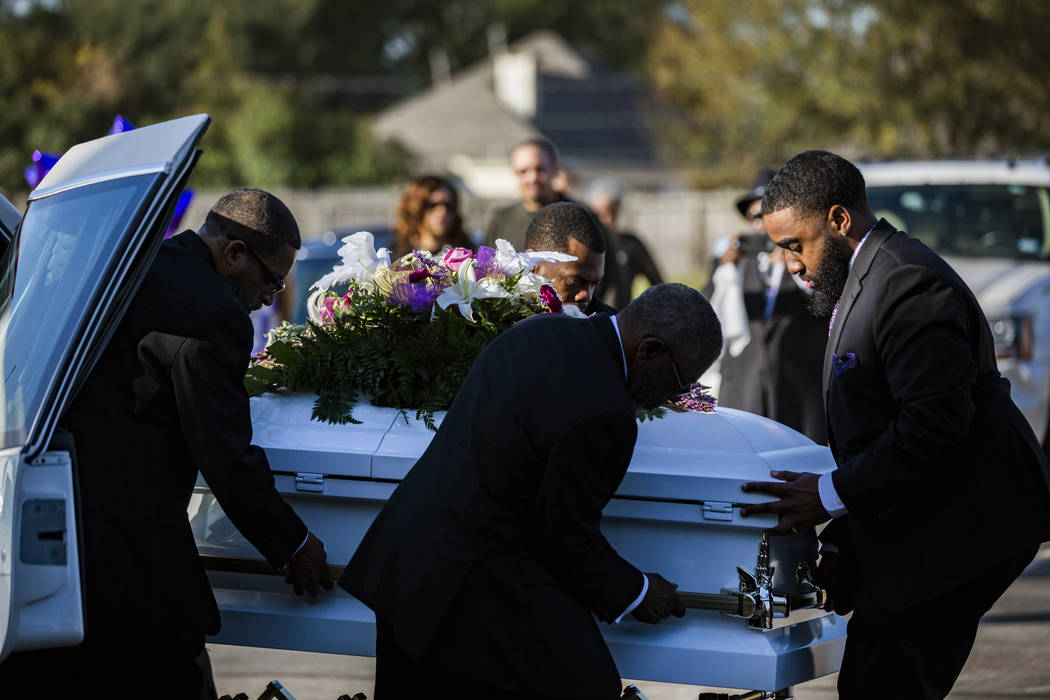 The casket of Jazmine Barnes is removed from the funeral hearse to be taken inside the Community of Faith Church for a memorial service, Tuesday, Jan. 8, 2019, in Houston. (Marie De Jesus/Houston ...