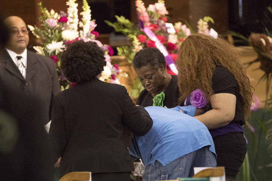 Three women hold a man as he becomes emotional approaching the casket of Jazmine Barnes during a viewing ceremony before the memorial services on Tuesday, Jan. 8, 2019 at the Community of Faith Ch ...