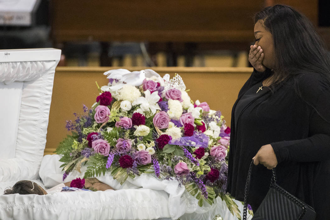 A mourner approaches the casket of Jazmine Barnes during a viewing ceremony before the memorial services on Tuesday, Jan. 8, 2019 at the Community of Faith Church in Houston. Barnes was fatally s ...