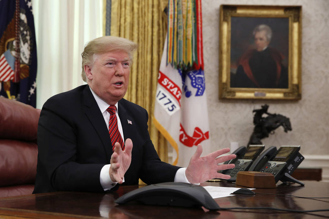 President Donald Trump on Christmas Day, Tuesday, Dec. 25, 2018, in the Oval Office of the White House. (AP Photo/Jacquelyn Martin)