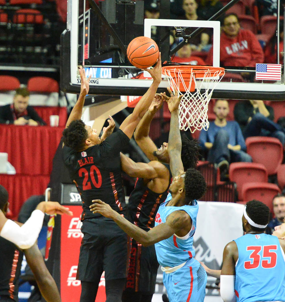 UNLV Rebels forward Nick Blair (20) rebounds the ball during the second half of the UNLV Rebels and the New Mexico Lobos NCAA basketball game at the Thomas & Mack Center in Las Vegas on Tuesda ...