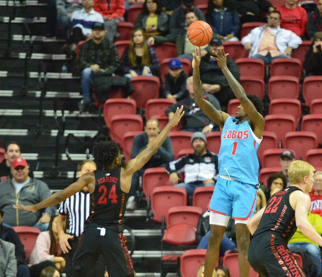 New Mexico Lobos forward Corey Manigault (1) shoots the ball over UNLV Rebels forward Joel Ntambwe (24) during the second half of the UNLV Rebels and the New Mexico Lobos NCAA basketball game at t ...