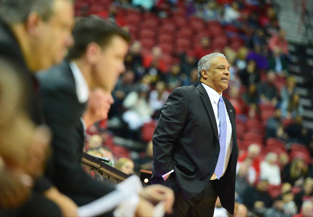 UNLV Rebels head coach Marvin Menzies talks to his players during the second half of the UNLV Rebels and the New Mexico Lobos NCAA basketball game at the Thomas & Mack Center in Las Vegas on T ...