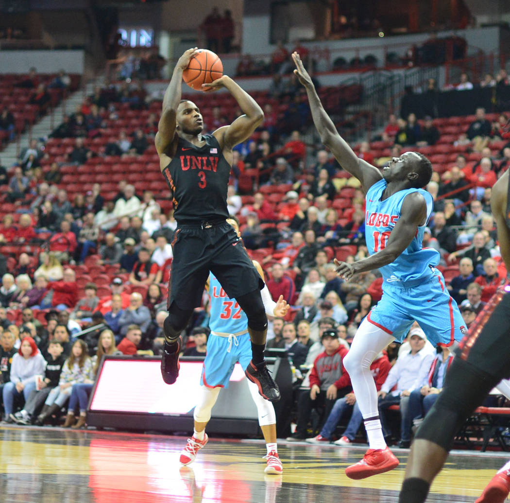 UNLV Rebels guard Amauri Hardy (3) shoots the ball from the lane during the second half of the UNLV Rebels and the New Mexico Lobos NCAA basketball game at the Thomas & Mack Center in Las Vega ...