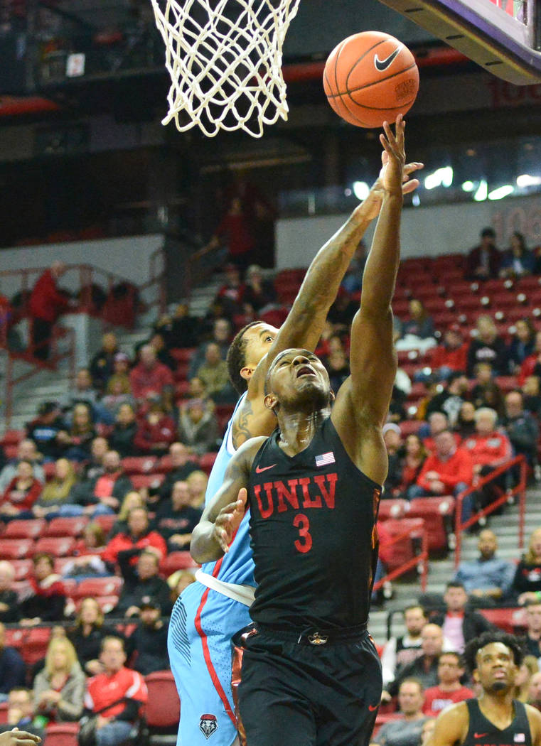 UNLV Rebels guard Amauri Hardy (3) shoots the ball during the second half of the UNLV Rebels and the New Mexico Lobos NCAA basketball game at the Thomas & Mack Center in Las Vegas on Tuesday, ...