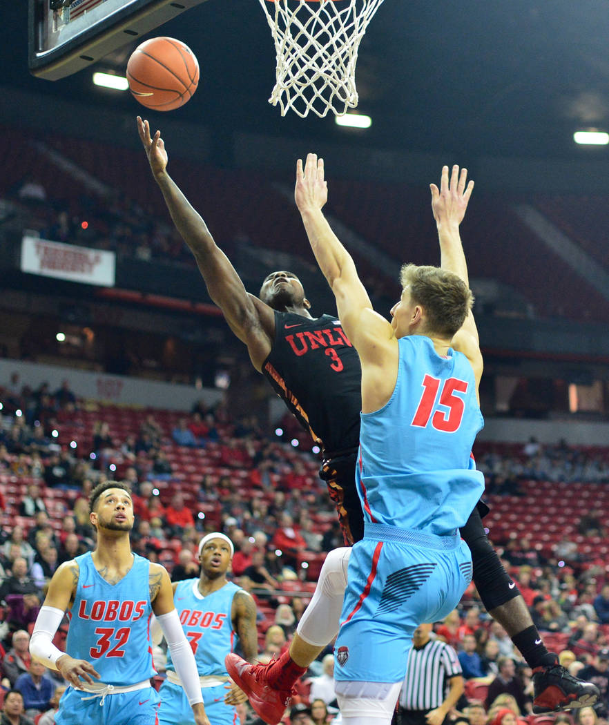 UNLV Rebels guard Amauri Hardy (3) shoots the ball over New Mexico Lobos center Vladimir Pinchuk (15) during the first half of the UNLV Rebels and the New Mexico Lobos NCAA basketball game at the ...