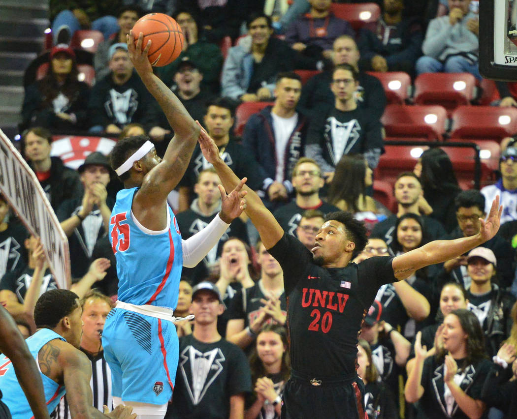 New Mexico Lobos forward Carlton Bragg (35) shoots the ball over UNLV Rebels forward Nick Blair (20) during the first half of the UNLV Rebels and the New Mexico Lobos NCAA basketball game at the T ...