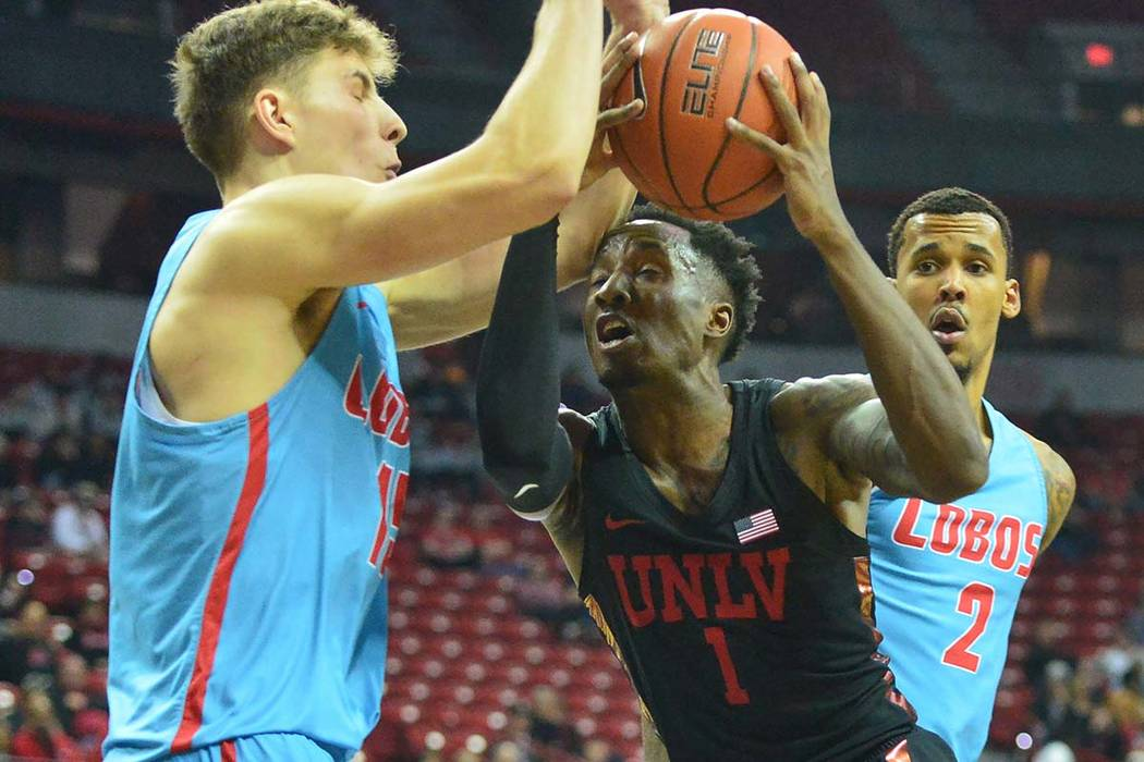 UNLV Rebels guard Kris Clyburn (1) runs into the elbow of New Mexico Lobos center Vladimir Pinchuk (15) during the first half of the UNLV Rebels and the New Mexico Lobos NCAA basketball game at th ...