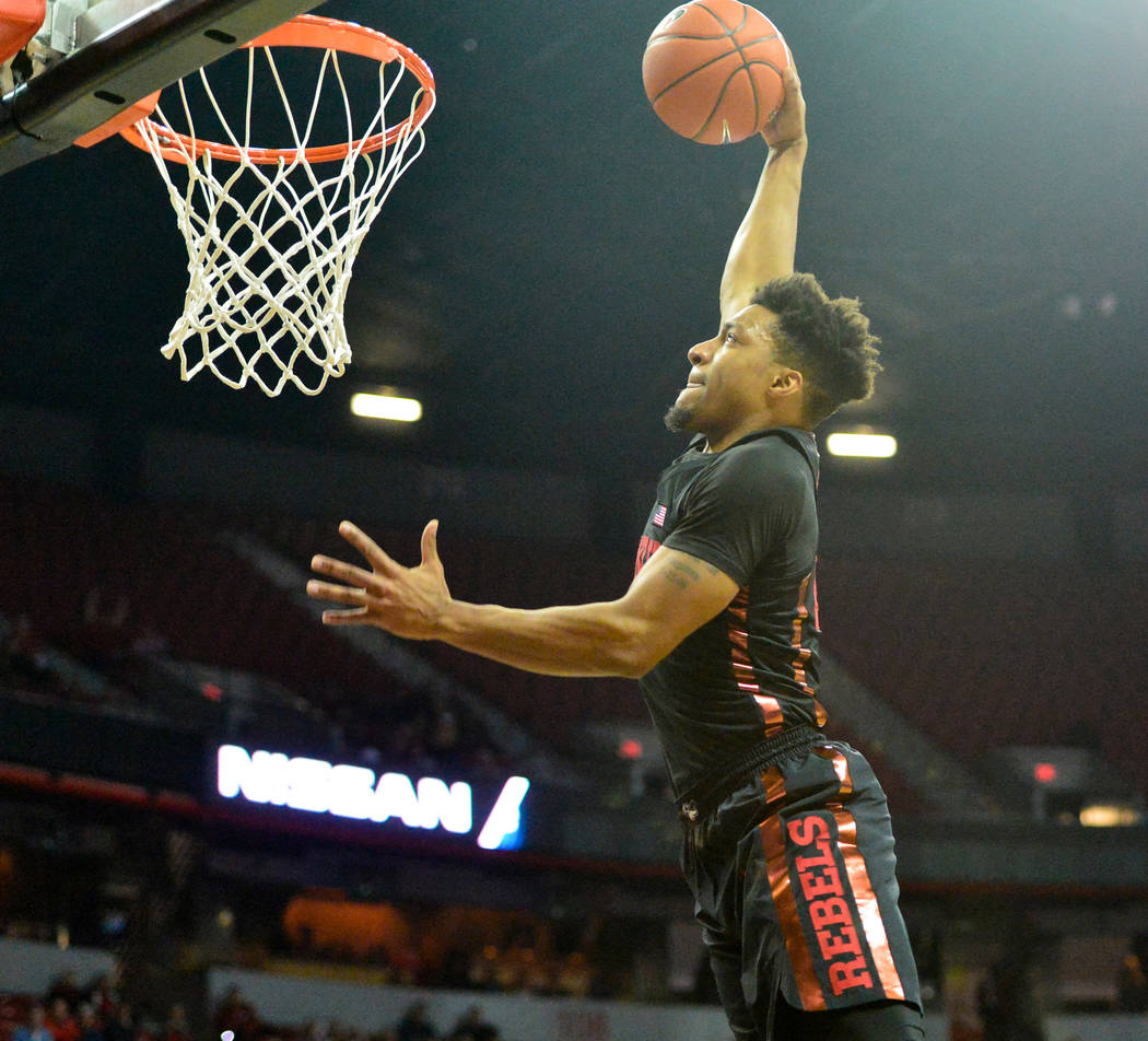 UNLV Rebels forward Nick Blair (20) dunks the ball during the first half of the UNLV Rebels and the New Mexico Lobos NCAA basketball game at the Thomas & Mack Center in Las Vegas on Tuesday, J ...