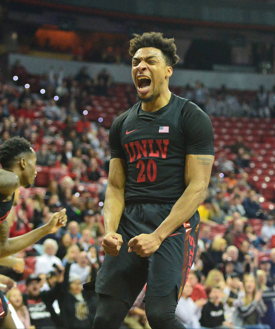 UNLV Rebels forward Nick Blair (20) celebrates a slam dunk during the first half of the UNLV Rebels and the New Mexico Lobos NCAA basketball game at the Thomas & Mack Center in Las Vegas on Tu ...
