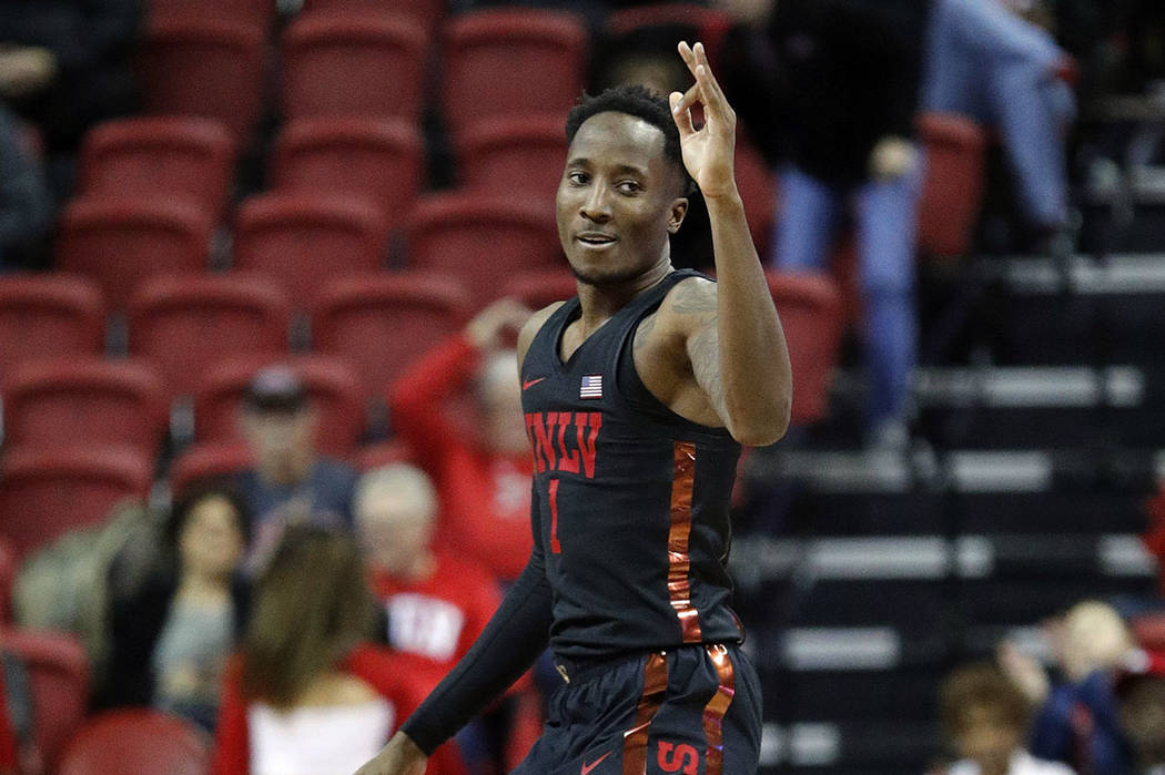 UNLV's Kris Clyburn reacts after making a 3-point shot against New Mexico during the second half on an NCAA college basketball game Tuesday, Jan. 22, 2019, in Las Vegas. (AP Photo/John Locher)