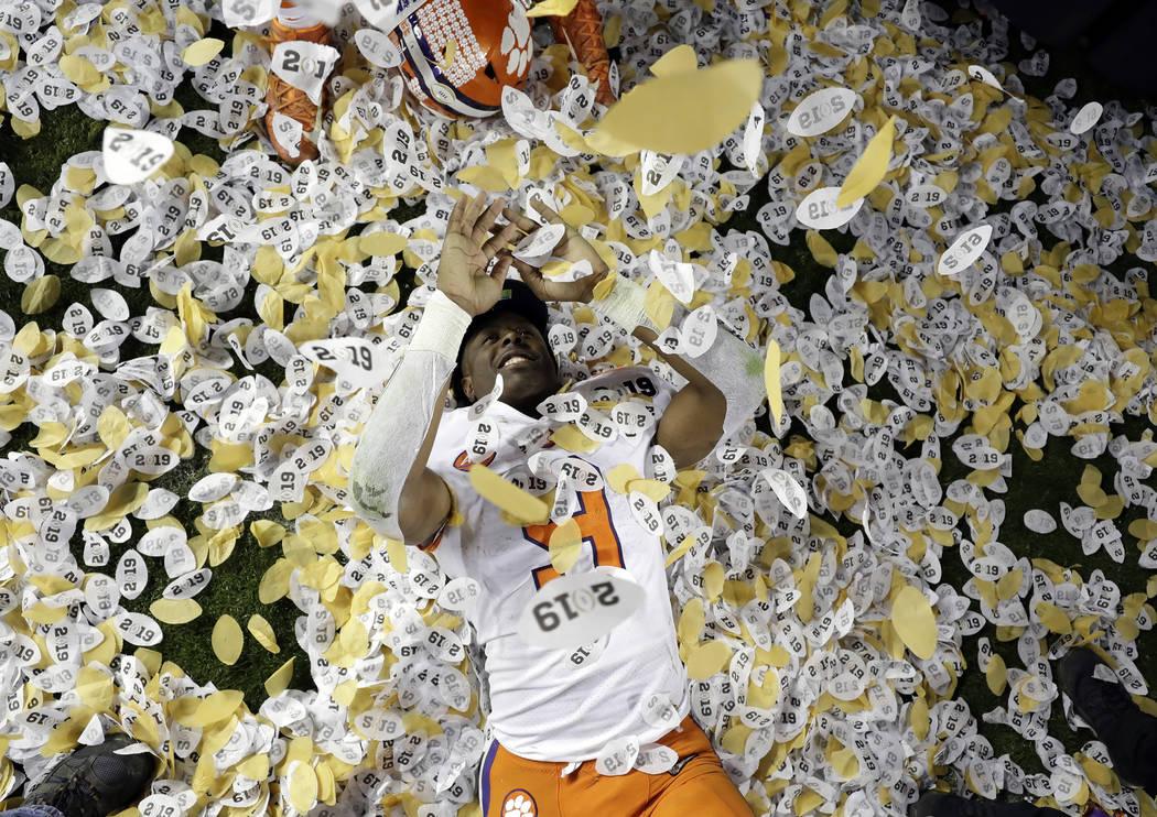 Clemson's Travis Etienne celebrates after the NCAA college football playoff championship game against Alabama, Monday, Jan. 7, 2019, in Santa Clara, Calif. Clemson beat Alabama 44-16. (AP Photo/Da ...