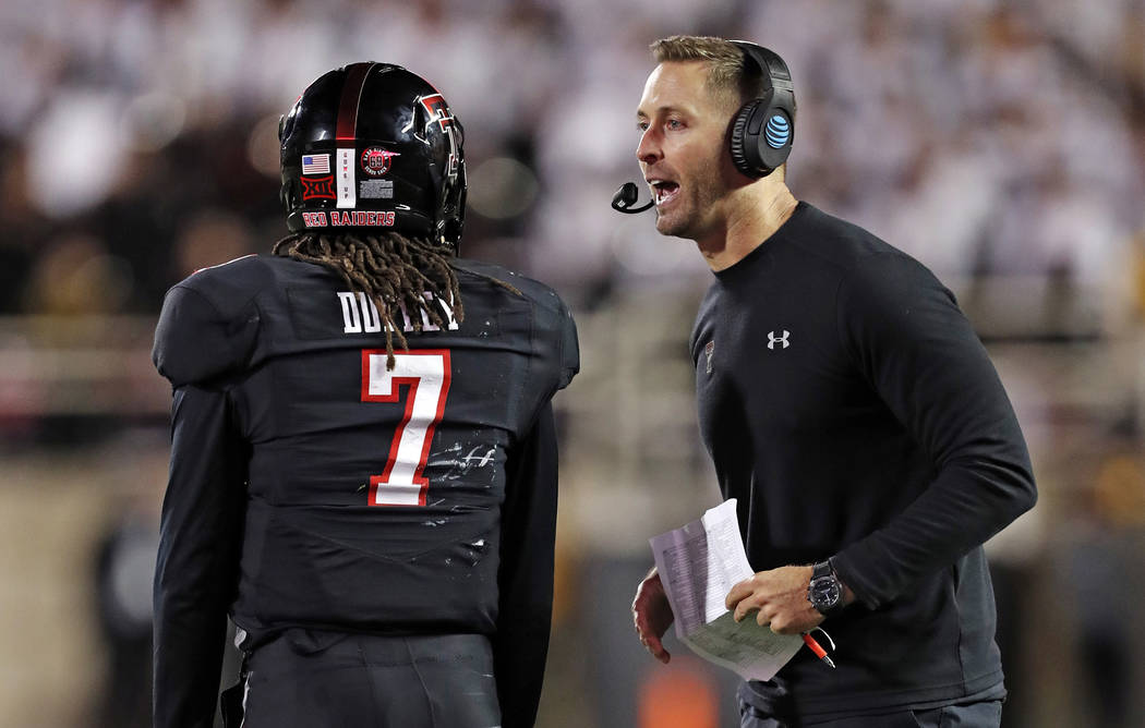 In this Saturday, Nov. 3, 2018, file photo, Texas Tech coach Kliff Kingsbury talks to quarterback Jett Duffey (7) during a timeout in the second half of an NCAA college football game against Oklah ...