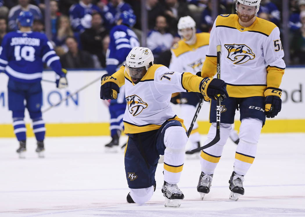 Nashville Predators defenseman P.K. Subban (76) celebrates his goal against the Toronto Maple Leafs as teammate Matt Irwin looks on during second-period NHL hockey game action in Toronto, Monday, ...