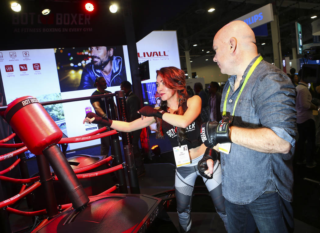Bo Kairat of Los Angeles demonstrates the Bot Boxer to Review-Journal reporter Chris Lawrence at the Sands Expo and Convention Center during CES in Las Vegas on Tuesday, Jan. 8, 2019. Chase Steven ...