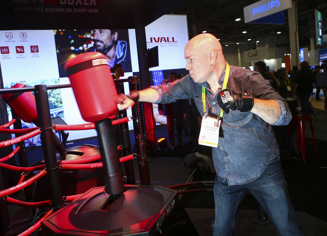 Review-Journal reporter Chris Lawrence tries out the Bot Boxer at the Sands Expo and Convention Center during CES in Las Vegas on Tuesday, Jan. 8, 2019. Chase Stevens Las Vegas Review-Journal @css ...