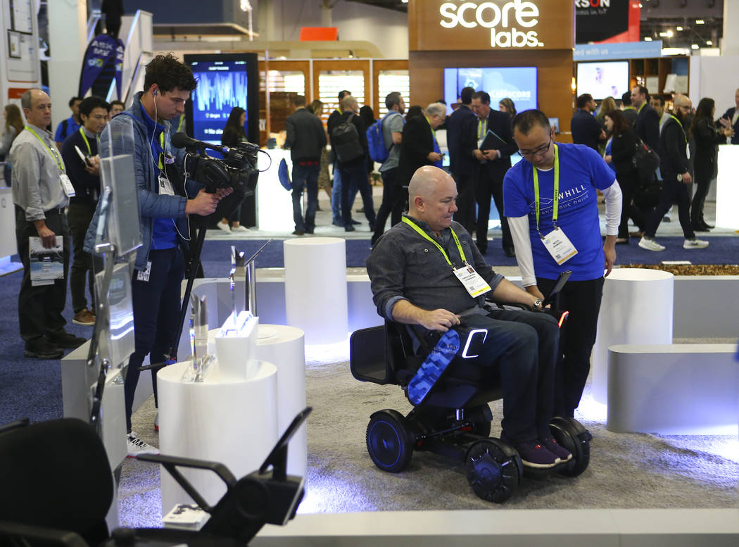 Review-Journal reporter Chris Lawrence tries out an autonomous wheelchair by Whill at the Sands Expo and Convention Center during CES in Las Vegas on Tuesday, Jan. 8, 2019. Chase Stevens Las Vegas ...
