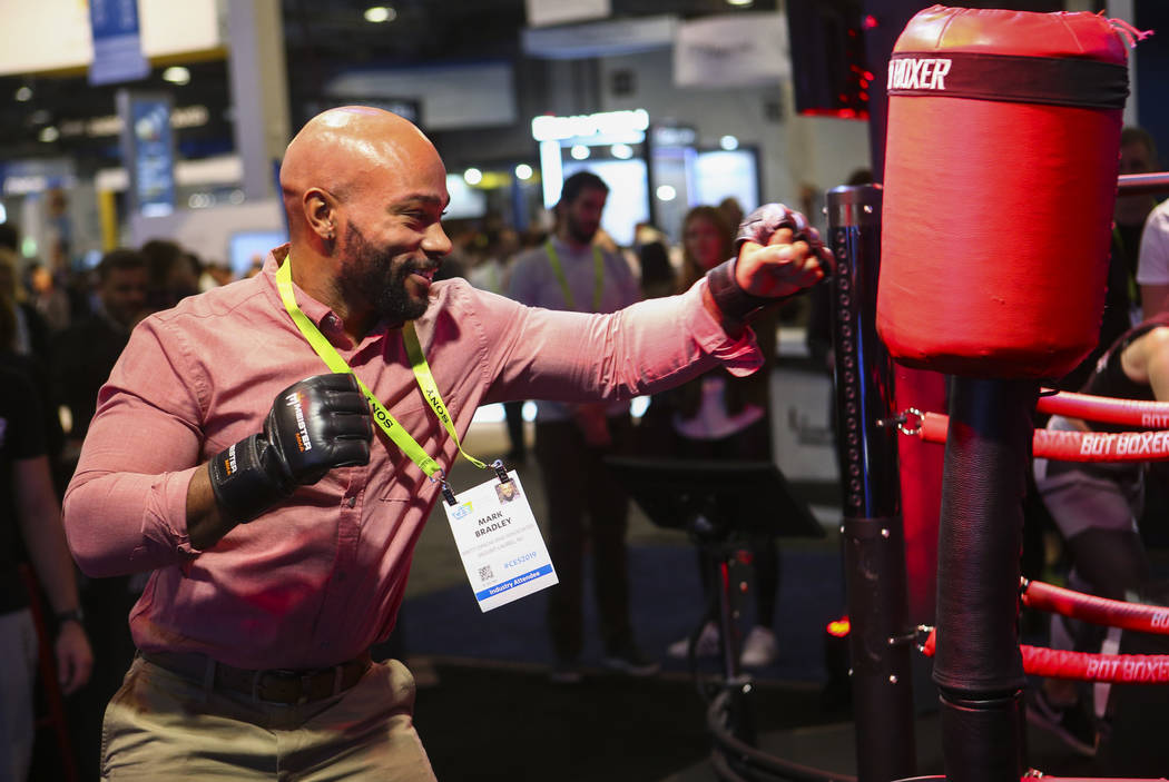Mark Bradley of New Jersey tries out the Bot Boxer at the Sands Expo and Convention Center during CES in Las Vegas on Tuesday, Jan. 8, 2019. Chase Stevens Las Vegas Review-Journal @csstevensphoto