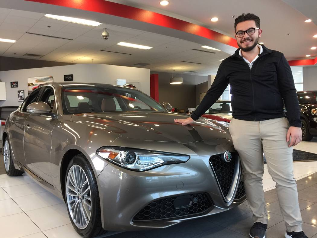 Findlay Alfa Romeo general sales manager Christopher Preciado shows off the 2019 Alfa Romeo Giulia Ti Lusso at the dealership at 210 N. Gibson Road in the Valley Automall. (Findlay)