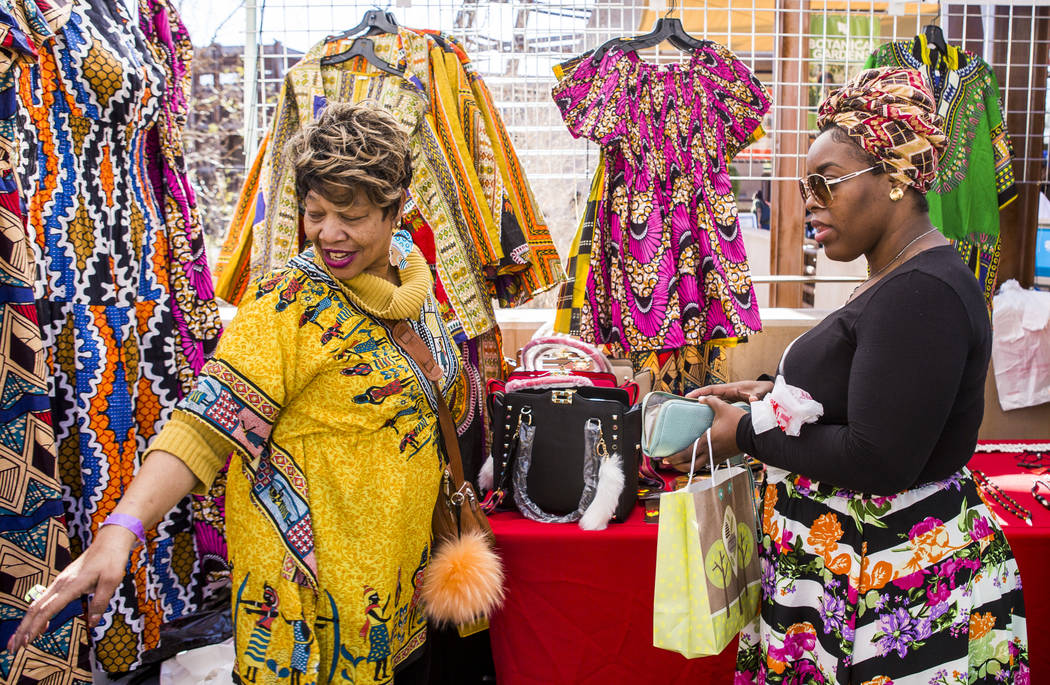 Beverly Williams helps Tiarra Kash pick out clothing from Handcraftivity Imports during a celebration of Black History Month at the Springs Preserve on Saturday, Feb. 17, 2018. Patrick Connolly L ...