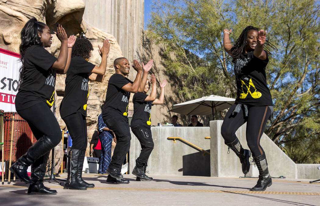 Cammie Griffin, right, a member of Molodi, a performance ensemble, twirls while other performers, from left, Danielle Hicks, Kishema Pendu Malik, Jason Nious and Angie Freeman, stomp and clap ...