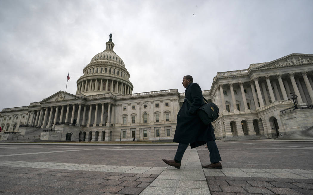 The Capitol is seen as the partial government shutdown lurches into a third week with President Donald Trump standing firm in his border wall funding demands, in Washington, Monday, Jan. 7, 2019. ...
