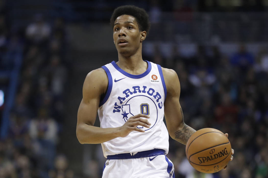 In this Jan. 12, 2018 file photo, Golden State Warriors' Patrick McCaw dribbles during the first half of an NBA basketball game against the Milwaukee Bucks in Milwaukee. McCaw is practicing with t ...