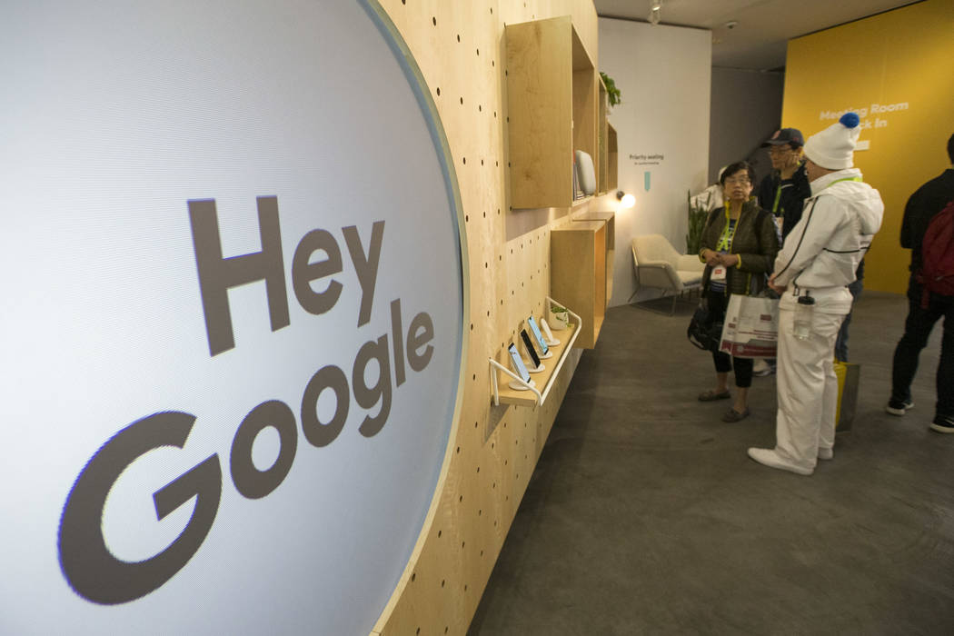 Attendees browse Google products on display at the Google booth on day one of CES at the Las Vegas Convention Center in Las Vegas on Tuesday, Jan. 8, 2019. Richard Brian Las Vegas Review-Journal @ ...