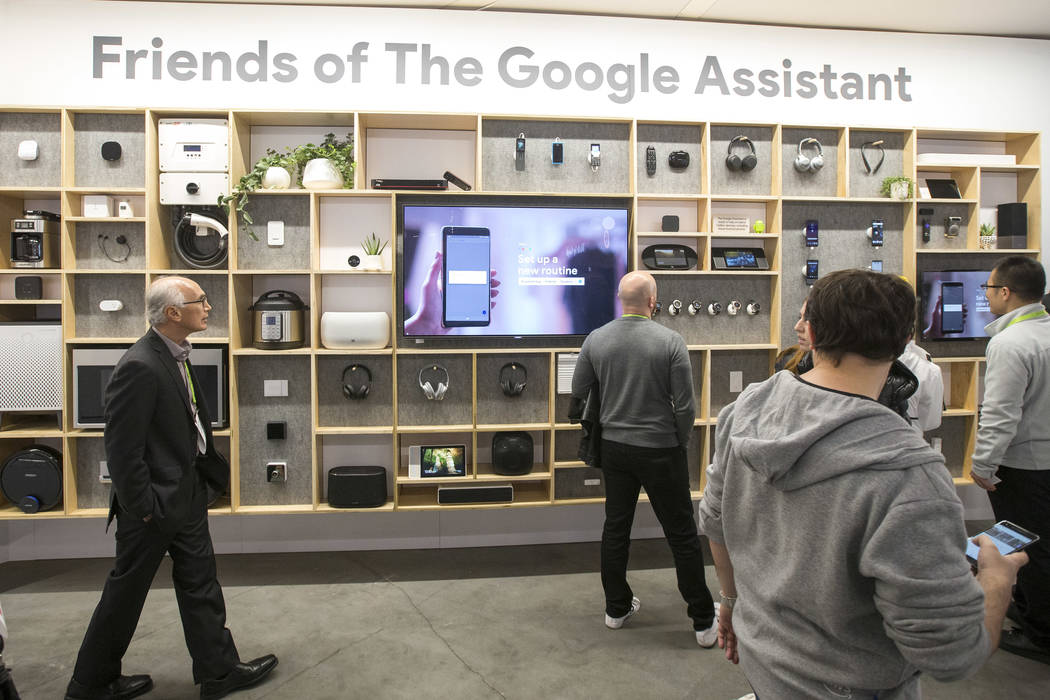 Attendees browse Google Assistant compatible products on display at the Google booth on day one of CES at the Las Vegas Convention Center in Las Vegas on Tuesday, Jan. 8, 2019. Richard Brian Las V ...