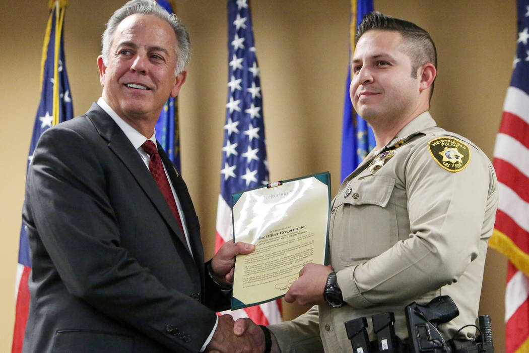 Clark County Sheriff Joe Lombardo presents Officer Gregory Anton with the Unit Meritorious Award at the Las Vegas Metropolitan Police Department headquarters in Las Vegas, Wednesday, Jan. 9, 2019. ...