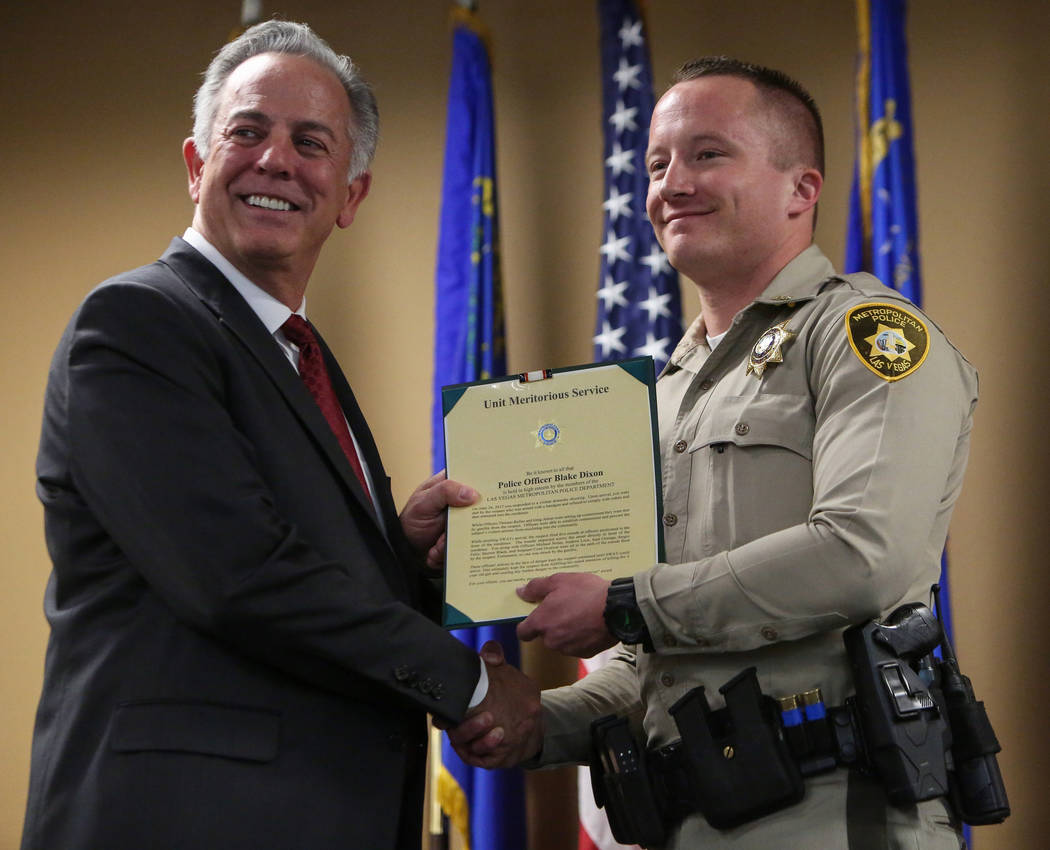 Clark County Sheriff Joe Lombardo presents Officer Blake Dixon with the Unit Meritorious Award at the Las Vegas Metropolitan Police Department headquarters in Las Vegas, Wednesday, Jan. 9, 2019. C ...