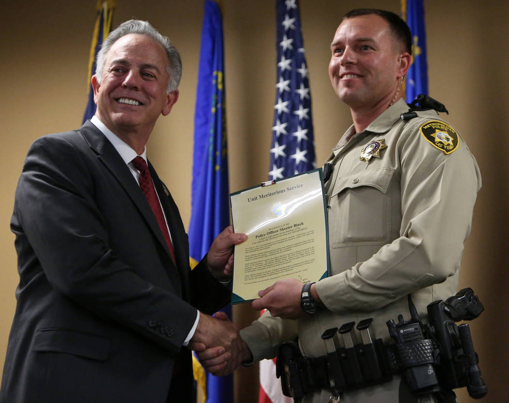 Clark County Sheriff Joe Lombardo presents Officer Skeeter Black with the Unit Meritorious Award at the Las Vegas Metropolitan Police Department headquarters in Las Vegas, Wednesday, Jan. 9, 2019. ...