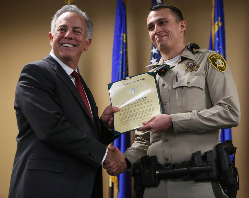 Clark County Sheriff Joe Lombardo presents Officer Thomas Keller with the Unit Meritorious Award at the Las Vegas Metropolitan Police Department headquarters in Las Vegas, Wednesday, Jan. 9, 2019. ...