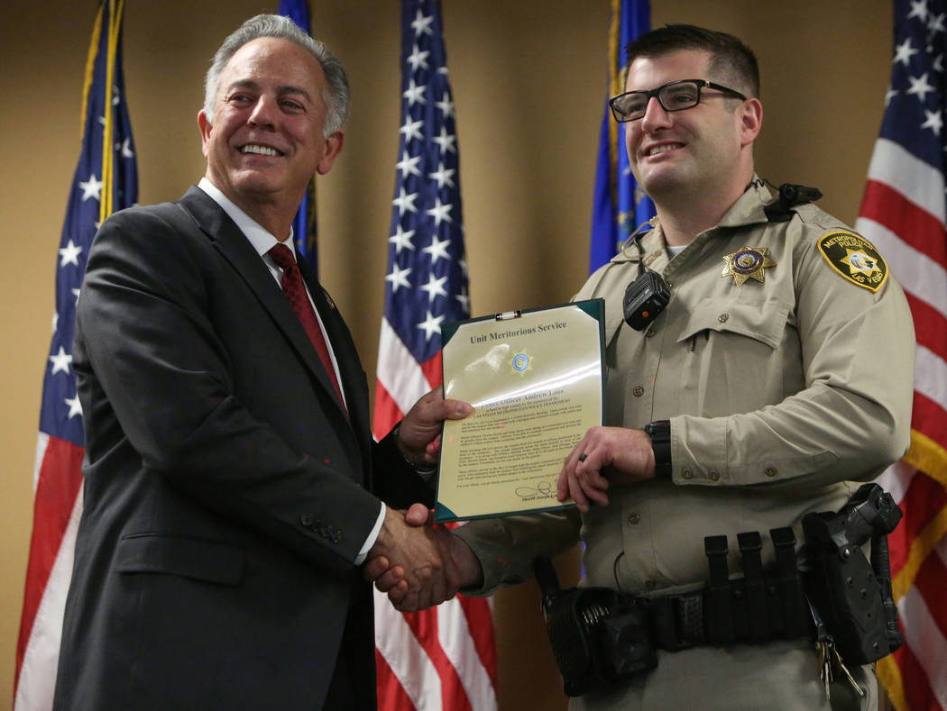 Clark County Sheriff Joe Lombardo presents Officer Andrew Loos with the Unit Meritorious Award at the Las Vegas Metropolitan Police Department headquarters in Las Vegas, Wednesday, Jan. 9, 2019. C ...