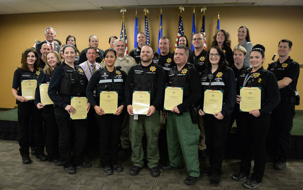 Clark County Sheriff Joe Lombardo stands with a group of crime scene analysts involved in the One October shooting as they are presented with the Unit Exemplary Award at the Las Vegas Metropolitan ...