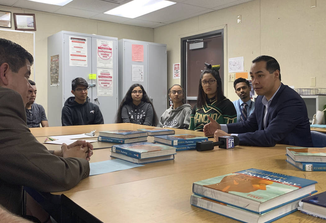Former Obama housing chief Julian Castro, right, meets with students at Rancho High School in Las Vegas, Tuesday, Jan. 8, 2019. Castro has met with Nevada Democrats and leaders of the Latino commu ...