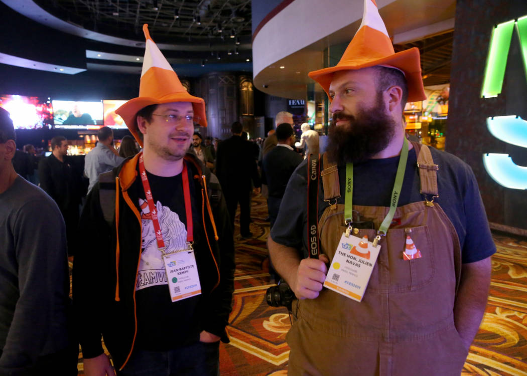 Jean-Baptiste Kempf, left, and Julien Navas of France make their way to the CES Opening Party presented by Omnia Nightclub at Caesars Palace in Las Vegas Tuesday, Jan. 8, 2019. Their hats represen ...