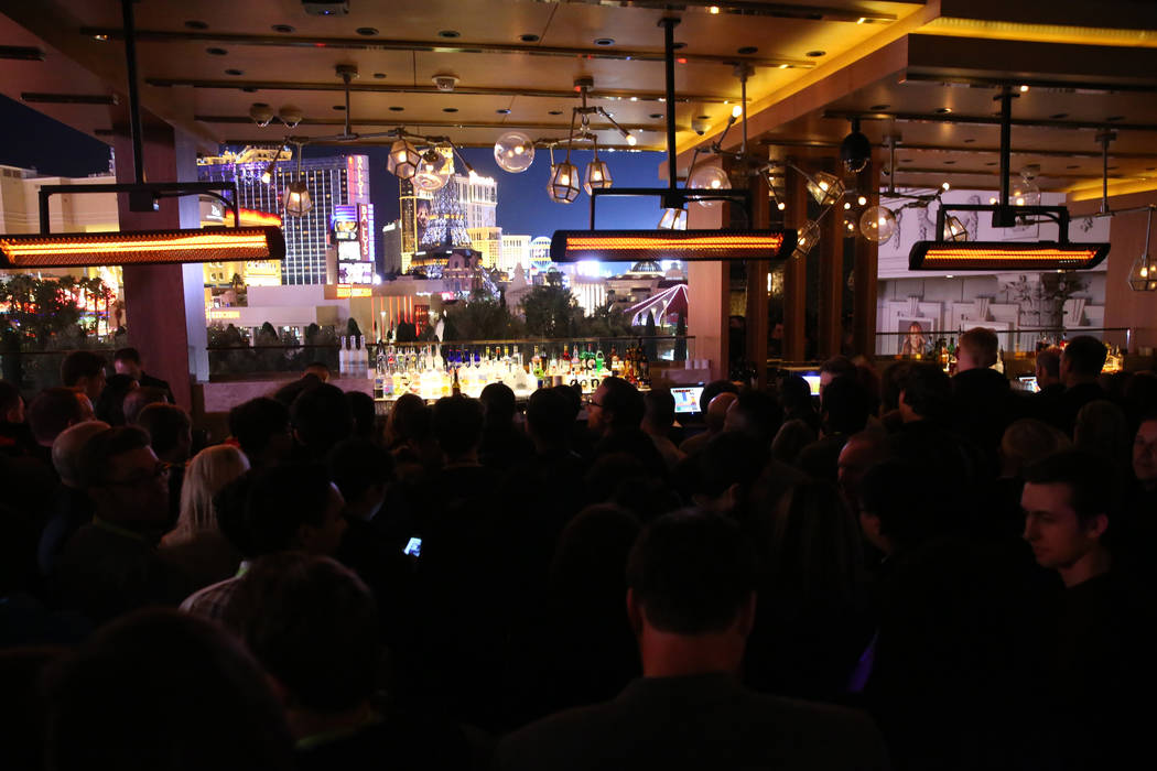 Conventioneers line up for free drinks at the Terrace bar in Omnia Nightclub at Caesars Palace in Las Vegas at the CES Opening Party Tuesday, Jan. 8, 2019. K.M. Cannon Las Vegas Review-Journal @KM ...