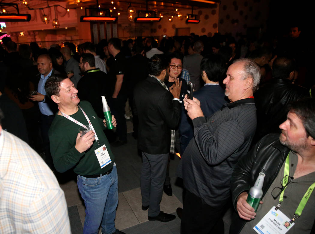 Joe Girardi of Hillsborough, New Jersey, left, and Bill Duda of Succasunna, New Jersey at the CES Opening Party presented by Omnia Nightclub at Caesars Palace in Las Vegas Tuesday, Jan. 8, 2019. K ...