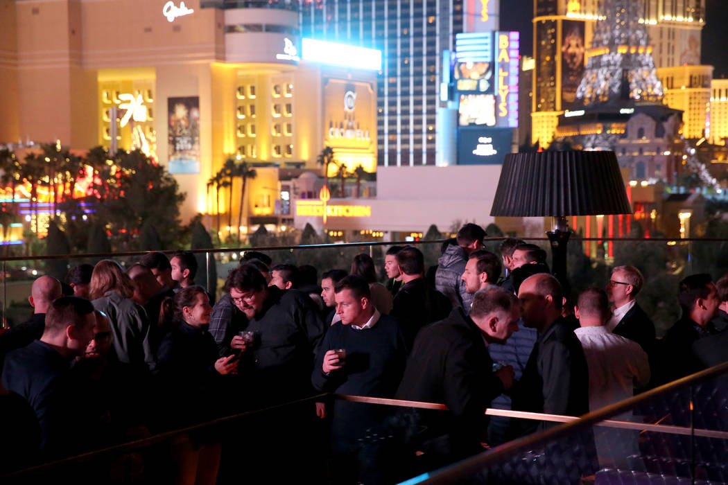 Conventioneers and club-goers mingle on the Terrace in Omnia Nightclub at Caesars Palace in Las Vegas at the CES Opening Party Tuesday, Jan. 8, 2019. K.M. Cannon Las Vegas Review-Journal @KMCannon ...