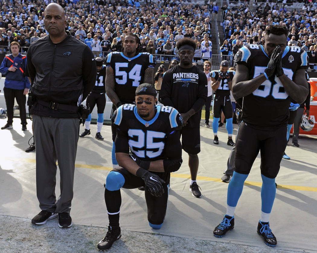 In this Nov. 25, 2018, file photo, Carolina Panthers' Eric Reid (25) kneels during the national anthem before an NFL football game against the Seattle Seahawks, in Charlotte, N.C. (AP Photo/Mike M ...