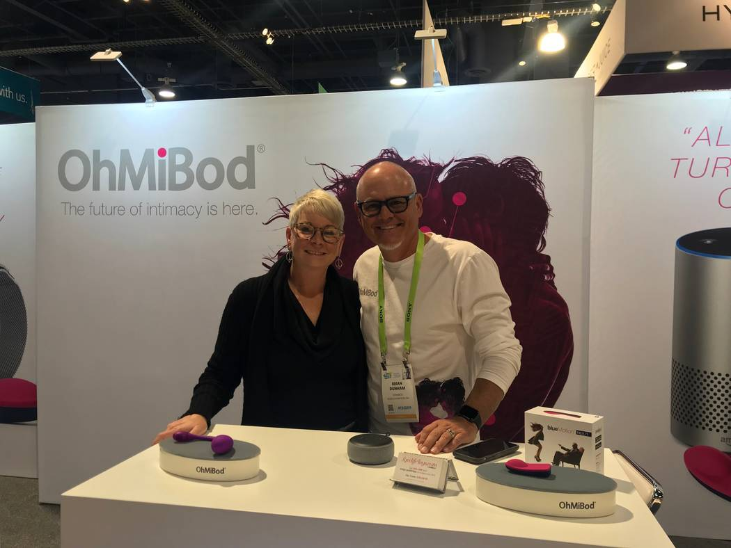 Suki Dunham, left, and her husband and OhMiBod co-founder, Biran Dunham, right, pose at their booth at CES on Wednesday, January 9, 2019. Jessie Bekker Las Vegas Review-Journal