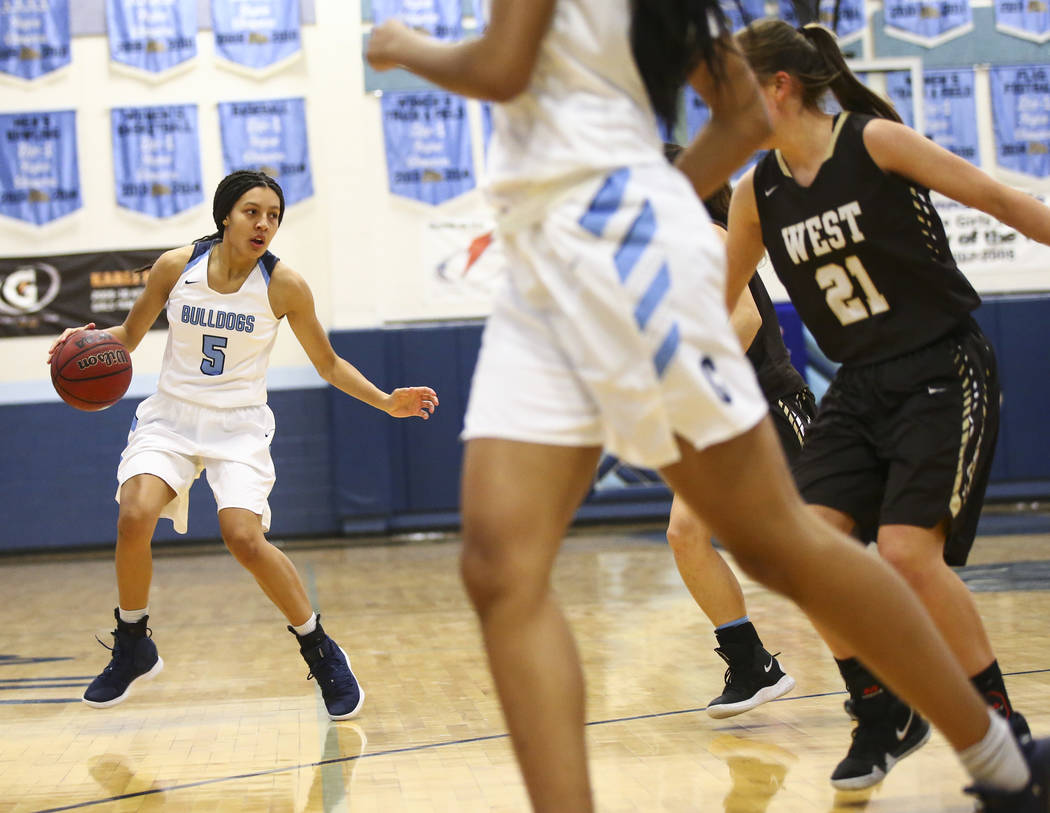 Centennial's Jade Thomas (5) moves the ball against West during a basketball game at Centennial High School in Las Vegas on Saturday, Dec. 29, 2018. Chase Stevens Las Vegas Review-Journal @cssteve ...