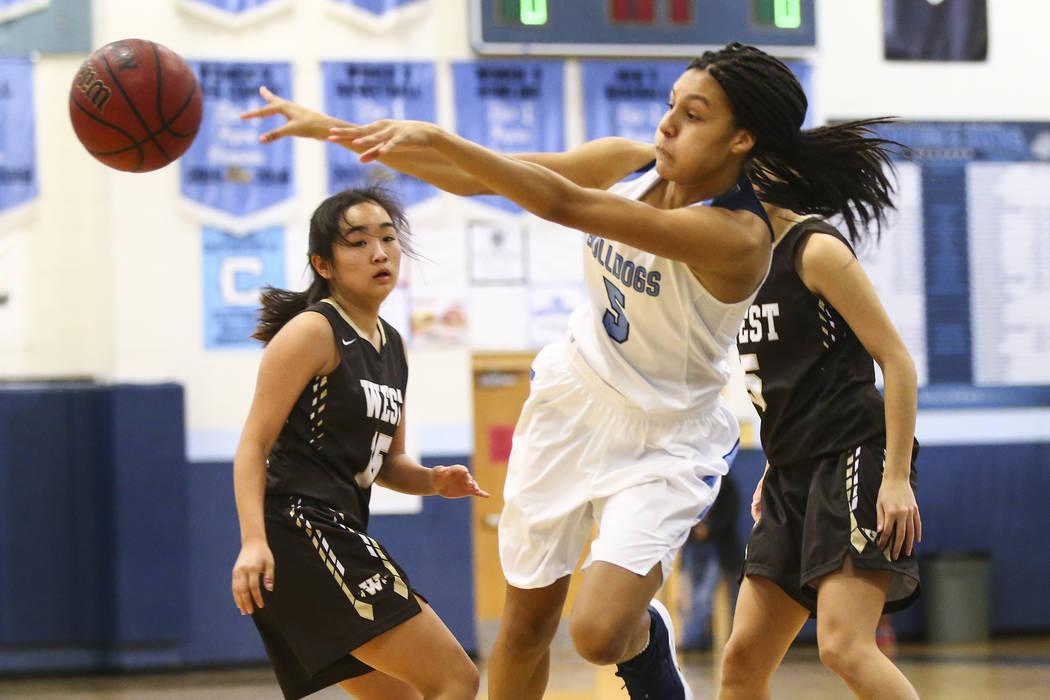 Centennial's Jade Thomas (5) throws the ball past West's Rachel Arakawa (15) during a basketball game at Centennial High School in Las Vegas on Saturday, Dec. 29, 2018. Chase Stevens ...