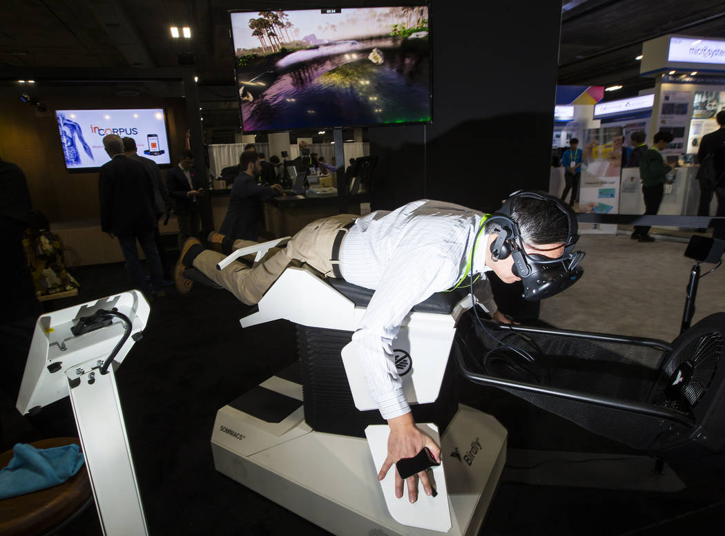 George Wong of Florida tries out VR by Birdly, which allows users to experience flight, at the Sands Expo and Convention Center during CES in Las Vegas on Wednesday, Jan. 9, 2019. Chase Stevens La ...