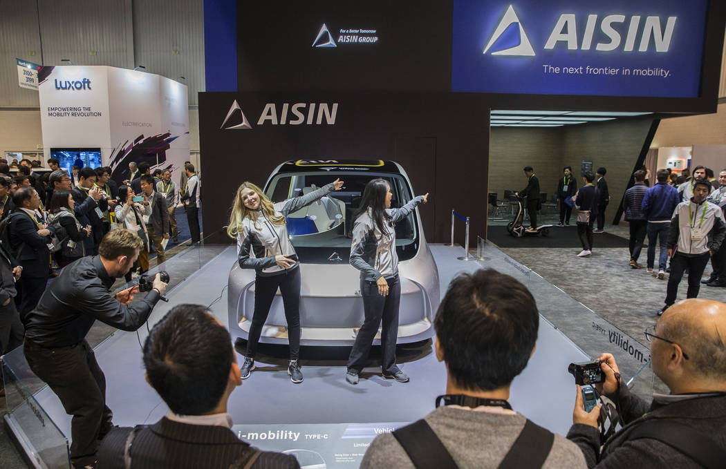 Hillary Billings, left, and Tala Marie lead a presentation for AISIN autonomous cars in the North Hall during the second day of CES 2019 on Wednesday, Jan. 9, 2019, at the Las Vegas Convention Cen ...