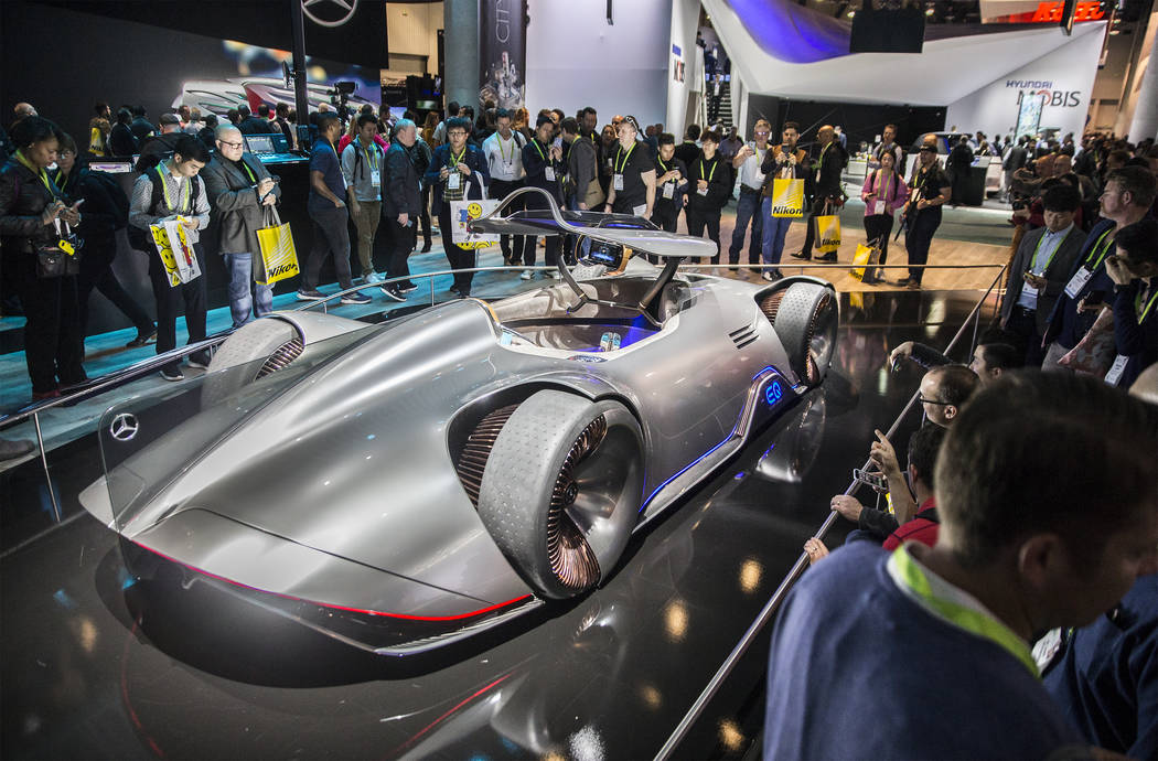 A Mercedes-Benz concept car draws a big crowd in the North Hall of the Las Vegas Convention Center during the second day of CES 2019 on Wednesday, Jan. 9, 2019, in Las Vegas. The four day tech eve ...