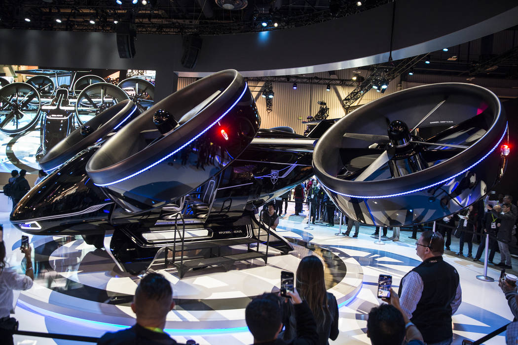 The Bell Nexus urban air mobility vehicle draws a big crowd in the North Hall during the second day of CES 2019 on Wednesday, Jan. 9, 2019, at the Las Vegas Convention Center, in Las Vegas. The fo ...