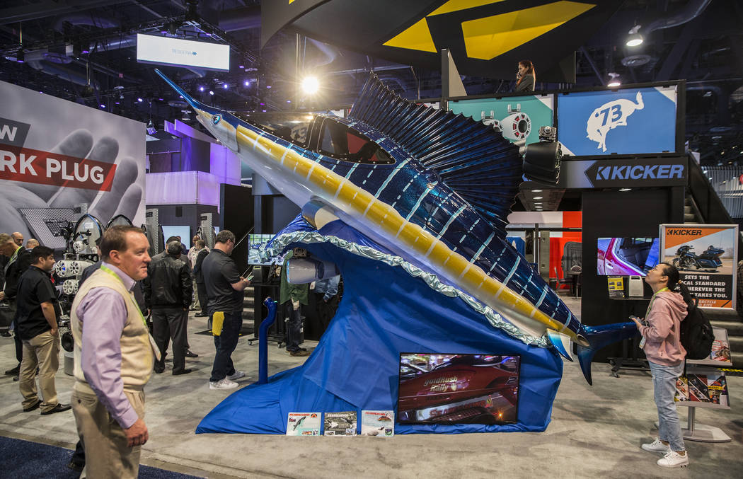 Convention goers explore a Seabreacher Y Model semi-submersible sea vehicle during the second day of CES 2019 on Wednesday, Jan. 9, 2019, at the Las Vegas Convention Center, in Las Vegas. The four ...